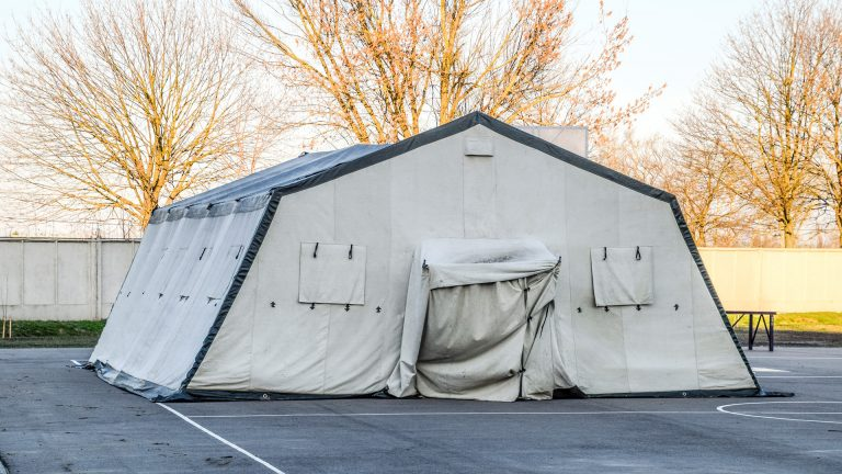 huge tent for a large group of people. Army headquarters tent. Awning canopy